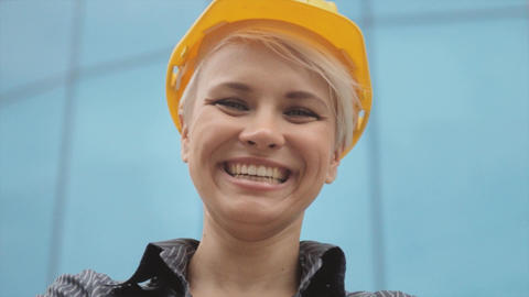 Portrait of Female Engineer with Helmet Smiling Footage