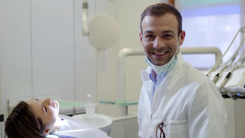 Portrait of Caucasian Dentist Smiling at Camera Stock Video Footage