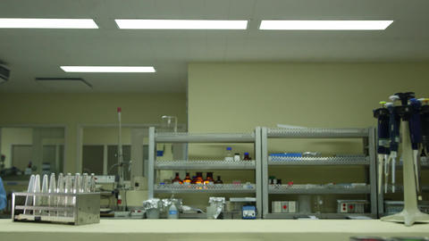 Biotech and Pharmaceutical Lab with Researcher Wearing mask Stock Video Footage