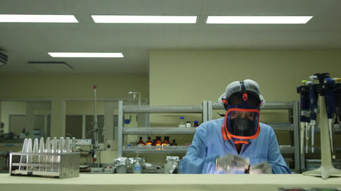 Biotech and Pharmaceutical Lab with Researcher Wearing mask Footage