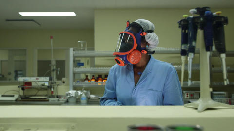Medical Facility and Pharmaceutical Laboratory with woman working Footage