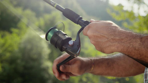 Man with Rod Fishing Trout on River in Italy Footage