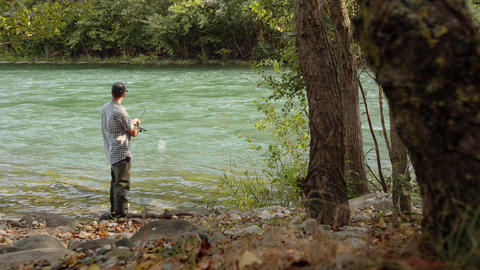 Man with Rod Fishing Trout on River in Italy Stock Video Footage