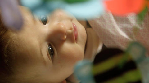 Beautiful Little Female Baby Smiling and Playing with toy... Stock Video Footage