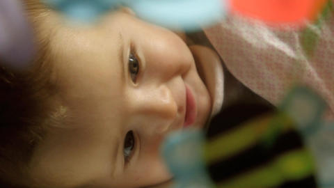 Beautiful Little Female Baby Smiling and Playing with toy in bed Footage