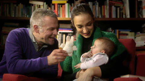 Family Portrait with Adult Couple Playing with Baby Stock Video Footage