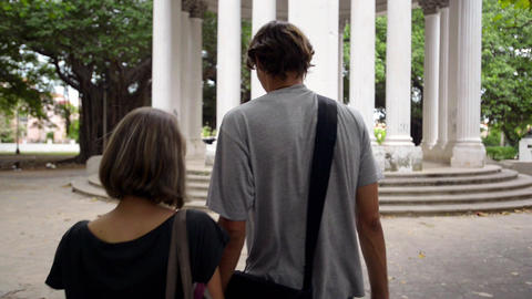 Young People and Tourism Boy and Girl Walking in city park Stock Video Footage