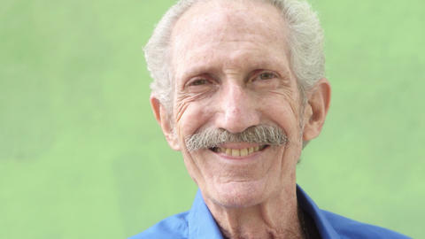 Portrait of Senior Hispanic Man Looking and Smiling Footage
