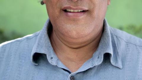 Portrait Of Happy Mature Hispanic Man Looking At C stock footage