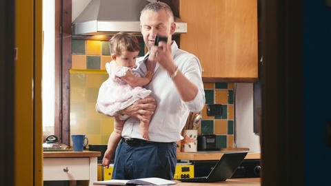 Multitasking Business Man with Child Working from home Footage
