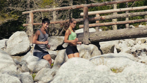 Man And Woman Running On Mountain Path stock footage