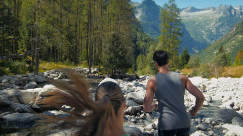 Man and Woman Running on Mountain Path Stock Video Footage