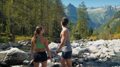Man and Woman Running on Mountain Path Footage