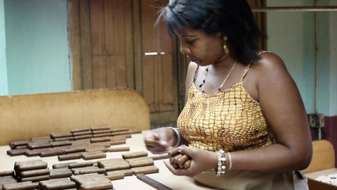 African American Woman Working in Cigar Factory in Stock Video Footage