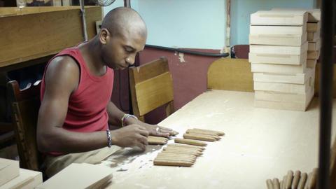 Young Black Man Working in Cigar Factory in Havana Footage