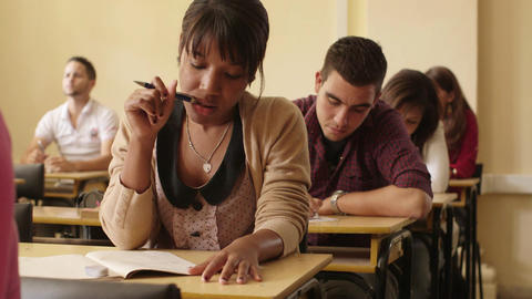 Women and Men at School Group of Young Students During Test Stock Video Footage