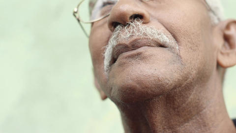 Old Black Man with Mustache Laughing Slow Motion Stock Video Footage