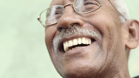 Old Black Man with Mustache Laughing Slow Motion Footage