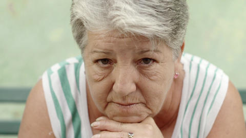 Portrait of Sad Old Woman with White Hair on Bench Footage
