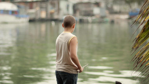 Boy Fishing On River stock footage