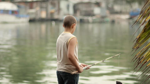 Boy Fishing in River Stock Video Footage