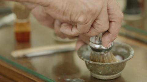 Closeup of Barber Preparing Cream with Shaving Bru Stock Video Footage