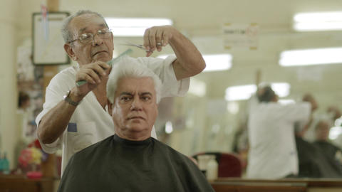 Elderly Barber Cutting Hair To Client in Old Fashi Stock Video Footage