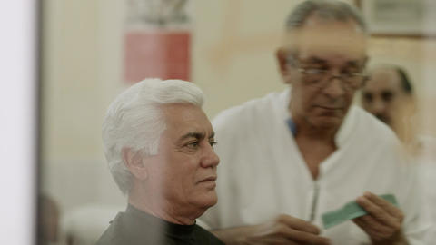 Senior Barber Cutting Hair To Client in Old Fashio Stock Video Footage