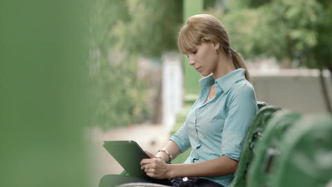 Young Woman Checking Emails on Digital Tablet Comp Footage