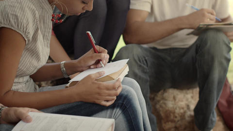 College Students in Park Doing Homework Stock Video Footage