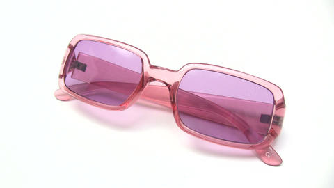 Cleaning Pink Sunglasses Stock Video Footage