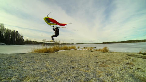 Kitewing skier jumping over a rock in slow motion Stock Video Footage