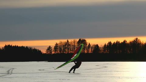 Kitewing Skier On A Lake During Sunset stock footage