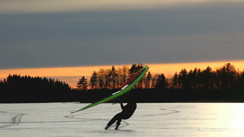 Kitewing skier on a lake during sunset Stock Video Footage