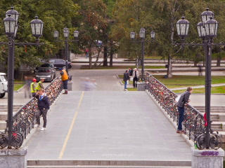 People walk across the bridge. Time Lapse. 320x240 Stock Video Footage