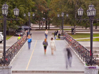 People walk across the bridge. Time Lapse. 320x240 Footage