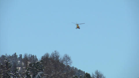 helicopter yellow fly over mountain 02 Stock Video Footage