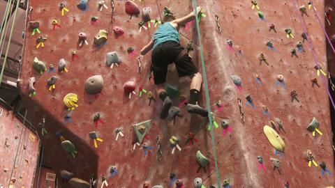 Boy Climbing a Rock Wall Stock Video Footage