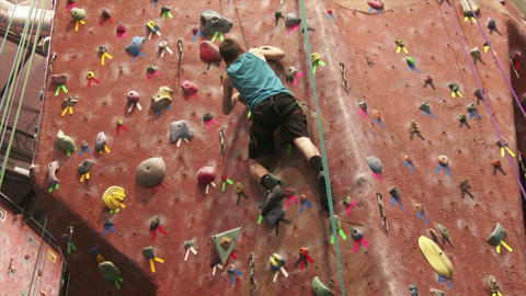 Boy Climbing a Rock Wall Footage