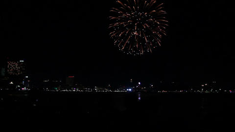 silhouettes of spectators watching fireworks at Pa Footage