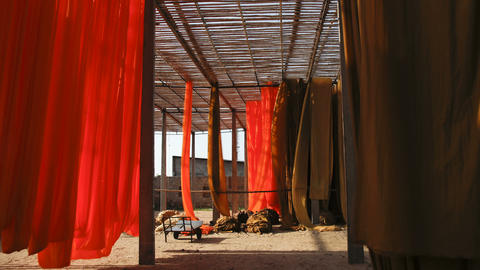 Newly dyed fabric being hung up to dry, Sari garme Live Action