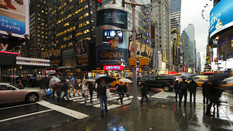 Busy intersection on a rainy evening on 42nd stree Footage