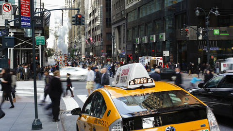 Taxis and street scene at intersection near Grand  Footage