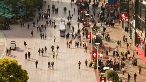 TL Pedestrians walking past stores on Nanjing Road Footage