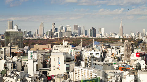 T/L Moving clouds over Shinjuku business, shopping Footage