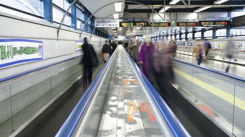 T/L Commuters on a moving walkway in Shibuya Stati Footage