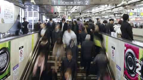T/L Commuters tmoving on an escalator in Shibuya S Footage