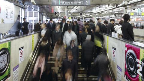 T/L Commuters tmoving on an escalator in Shibuya S Footage