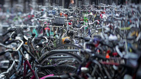 Bicycles parked outside the main train station in  Footage