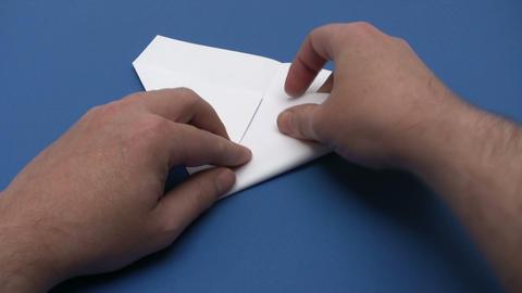 Folding a Paper Plane - Time Lapse Footage